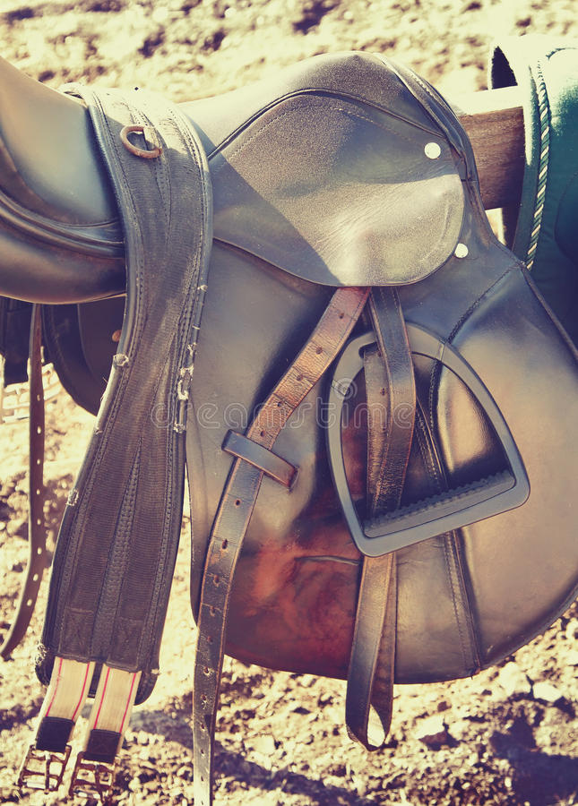 Saddle and brown leather belts stock photos