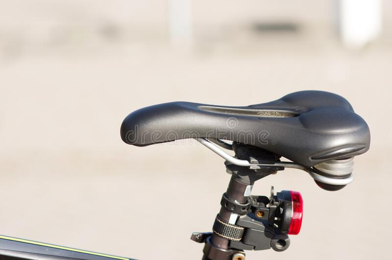 Saddle of a mountain bike. Closeup of a saddle of a mountain bike stock image