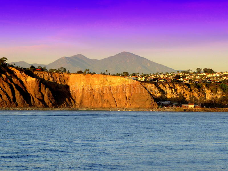 Saddleback Headlands. Dana Point headlands with Saddelback Mountain in the background and ocean in the foreground stock photography