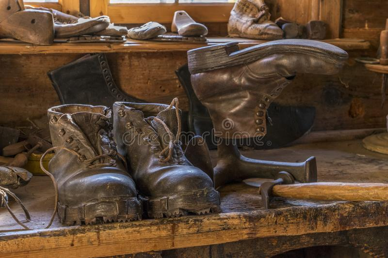 Farm and Winter Sports Museum, Schliersee, Bavaria. Saddlery and cobbler in the artisan house - Handwerkerhaus in the Markus Wasmeier Farm and Winter Sports royalty free stock image