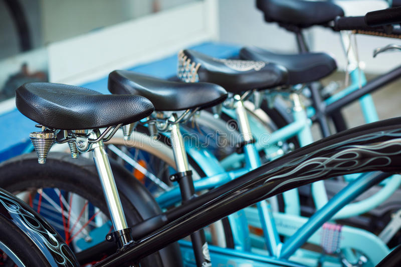 Saddles of a group of bicycles on parking royalty free stock photography