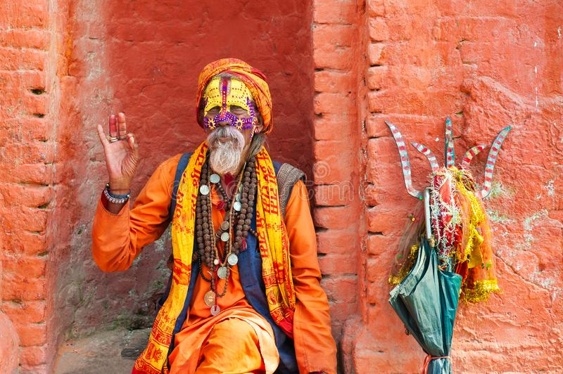 Sadhu holy man in Pashupatinath Temple in Kathmandu, Nepal. Kathmandu, Nepal - October, 20, 2018: Sadhu holy man in traditional clothes in Pashupatinath Temple royalty free stock photography