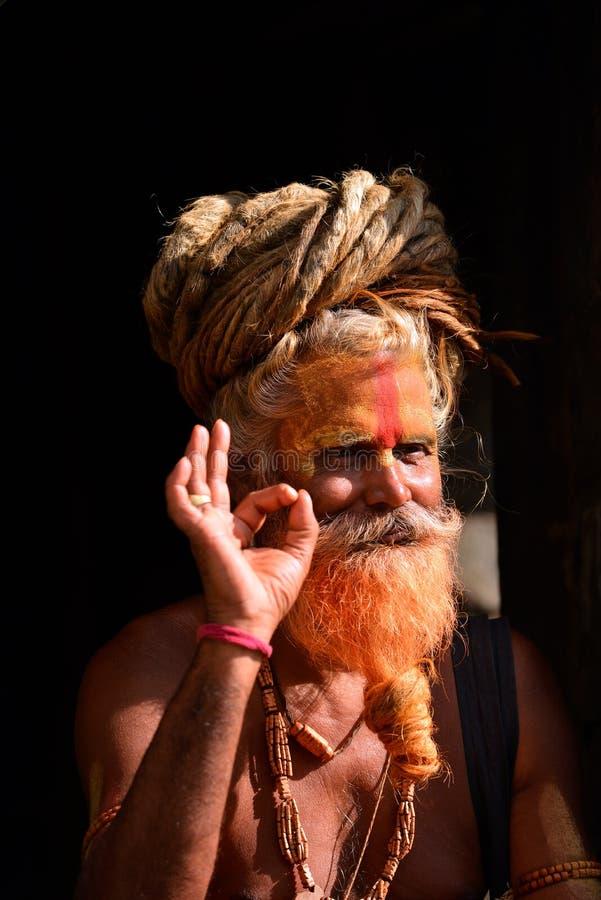 Sadhu man with dreadlocks and painted face in Pashupatinath. KATHMANDU - OCT 8: Sadhu at Pashupatinath in Kathmandu. Sadhus are holy men who have chosen to live royalty free stock image