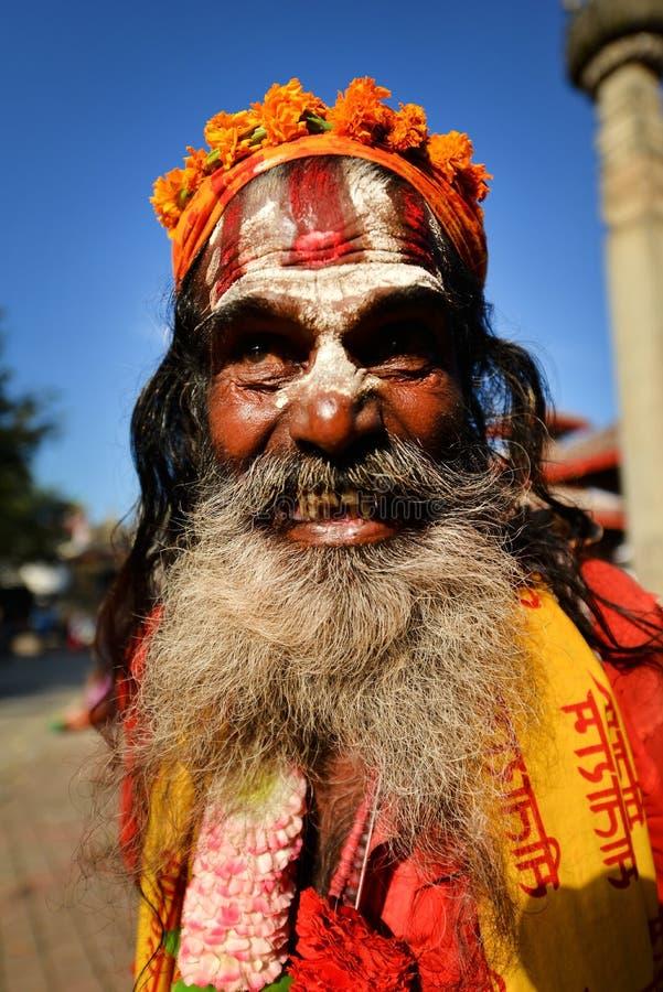 Sadhu man seeking alms in Durbar square. Kathmandu, Nepal royalty free stock images