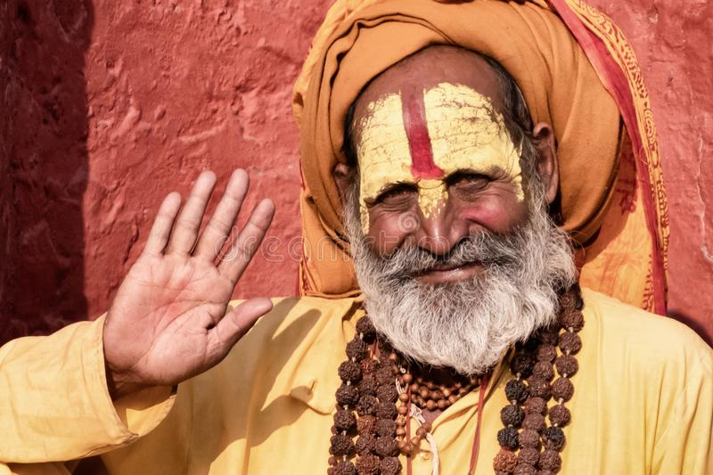 Sadhu man with traditional painted face in Pashupatinath Temple of Kathmandu, Nepal.Sadhu man refer to holy person.Nepal text in royalty free stock images