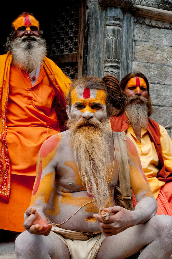 Sadhu men, blessing in Pashupatinath Temple. KATHMANDU, NEPAL, PASHUPATINATH TEMPLE - SEPTEMBER 21: Three Holy Sadhu men with traditional painted face, blessing royalty free stock photography