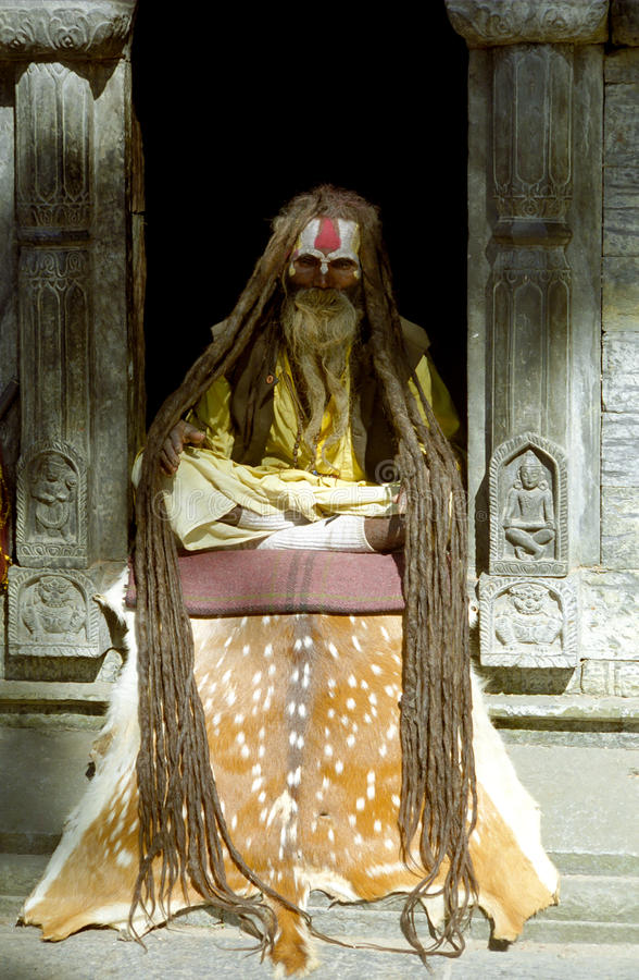 Sadhu, Pashupatinath, Nepal. A Hindi ascetic Sadhu sits still practicing yoga December 17, 1999 in Pashupatinath, Nepal royalty free stock image
