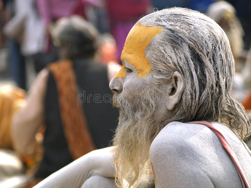 A sadhu resting. Mahashivaratri is one of the biggest festivals of Hindus. People from all over the world throng to Pashupatinath Temple in Kathmandu,Nepal,one royalty free stock photo