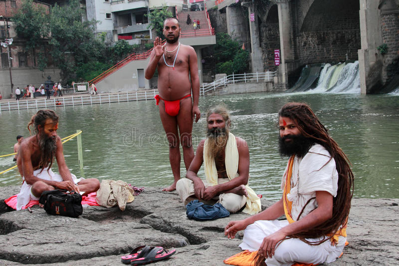 Sadhus come to bath in the river at Kumbh Mela. Unidentified Sadhus look as they come to bath in river Godavari during the Kumbh Mela on September 15, 2015 in royalty free stock photos