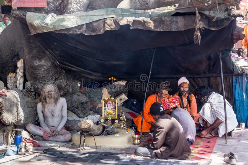 Sadhus in Haridwar. Sadhus, the holy men of the Hindus, sitting in a tent near the main ghat of the holy city of Haridwar, India royalty free stock images