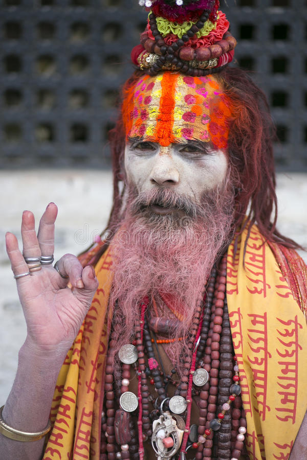 Sadhus. KATHMANDU - JULY 22: Sadhu at Pashupatinath Temple in Kathmandu, Nepal on July 22, 2013. Sadhus are holy men who have chosen to live an ascetic life and stock images