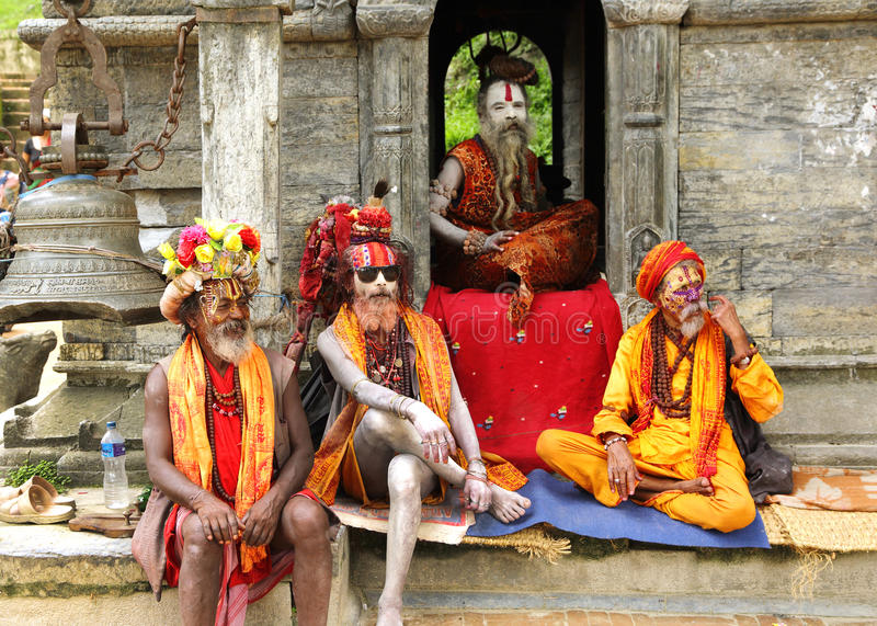 Sadhus in a temple near Sri Pashupatinath Temple. KATHMANDU, NEPAL-AUGUST 21: Sadhus sitting in a shrines near Pashupatinath temple on August 21, 2014, Kathmandu stock image