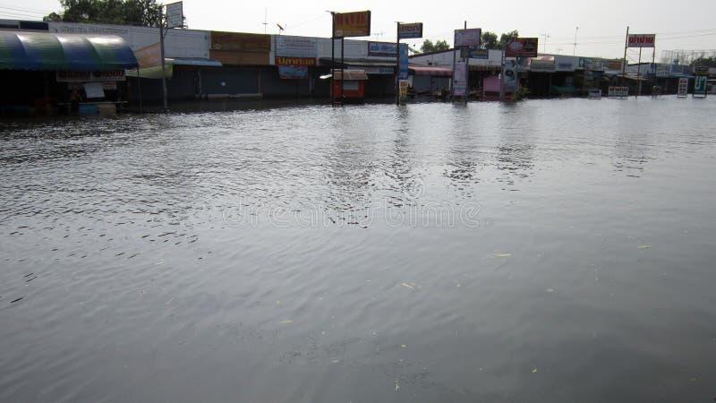 Sadness. LAMLUKKA (PATHUMTHANI), THAILAND – CIRCA NOVEMBER 2011 – A deserted flooded road circa November 2011 in Lamlukka. The entire province has royalty free stock photos