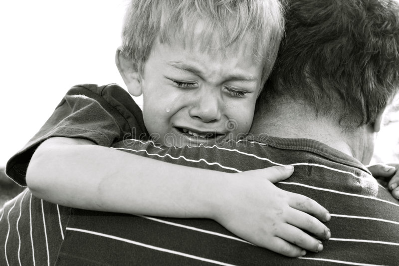 Sadness. Crying Boy being comforted by his father