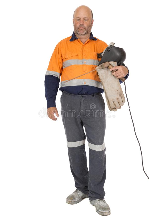 Sadness or Depression. A middle aged manual worker with eyes looking down, an expression of sadness or depression, mental health an issue in the work force royalty free stock photos