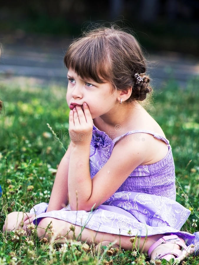 Sadness in her eyes. Portrait of small sad girl stock images