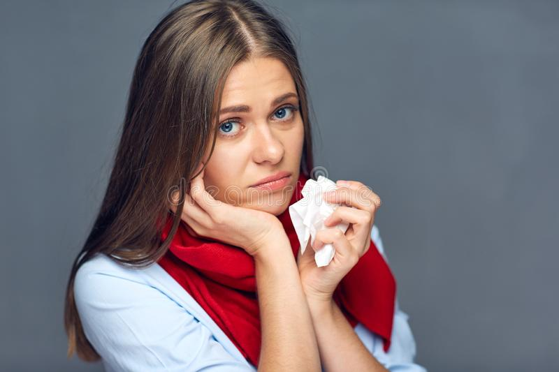 Sadness woman with flu or allergies sick holding paper tissue. royalty free stock photos