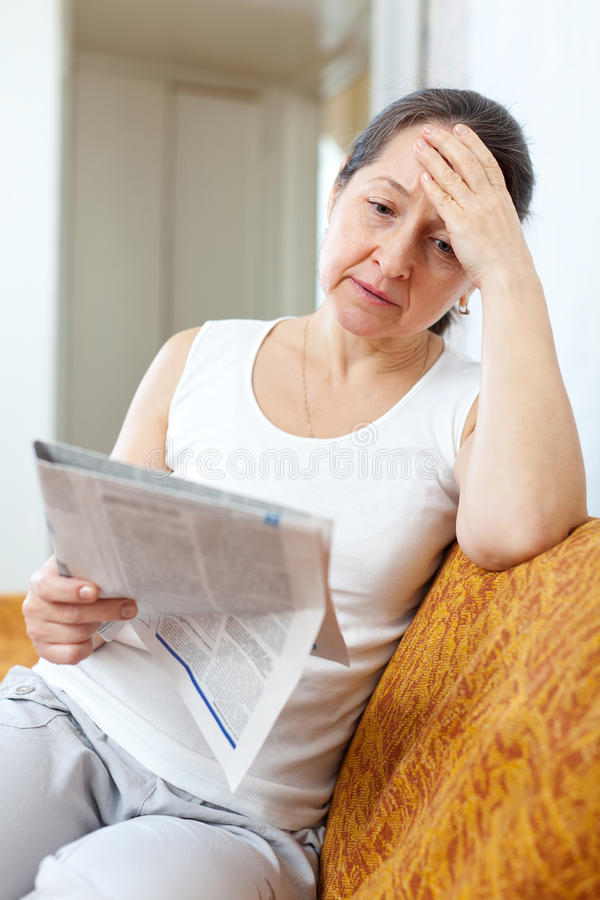 Download Sadness  Woman With Newspaper Stock Images - Image: 35193764