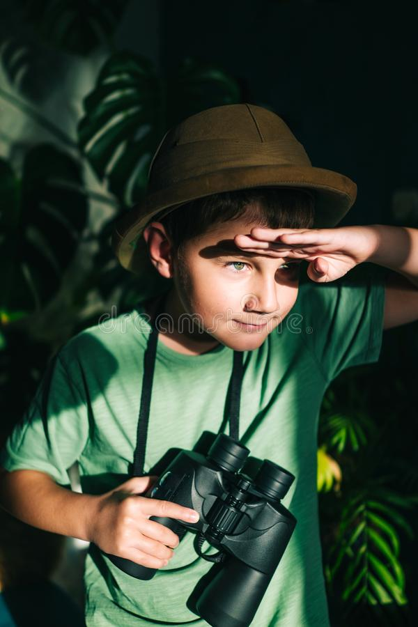 Safari boy playing stock image