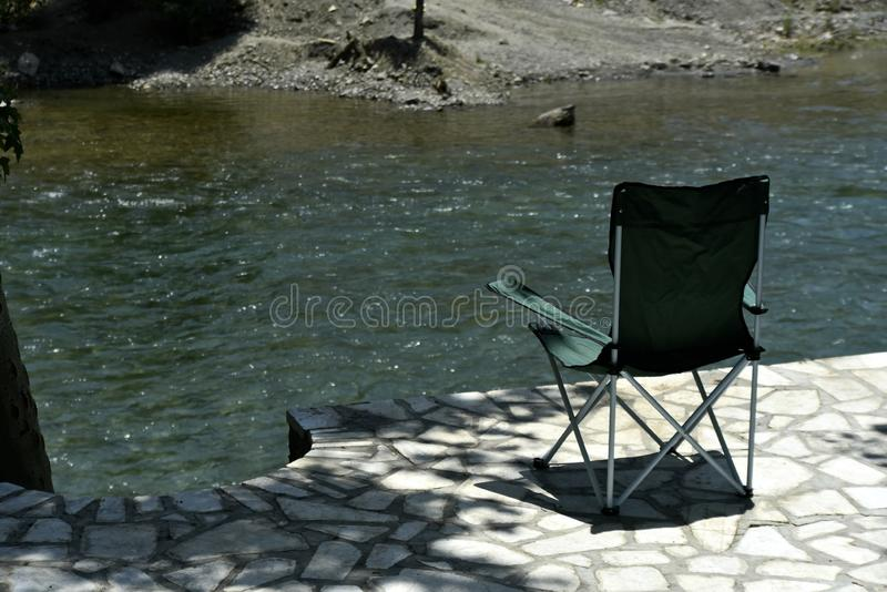 Safari Chair with the View of Zayandeh rood Zayanderud, Esfahan, Iran at the day.  stock photography