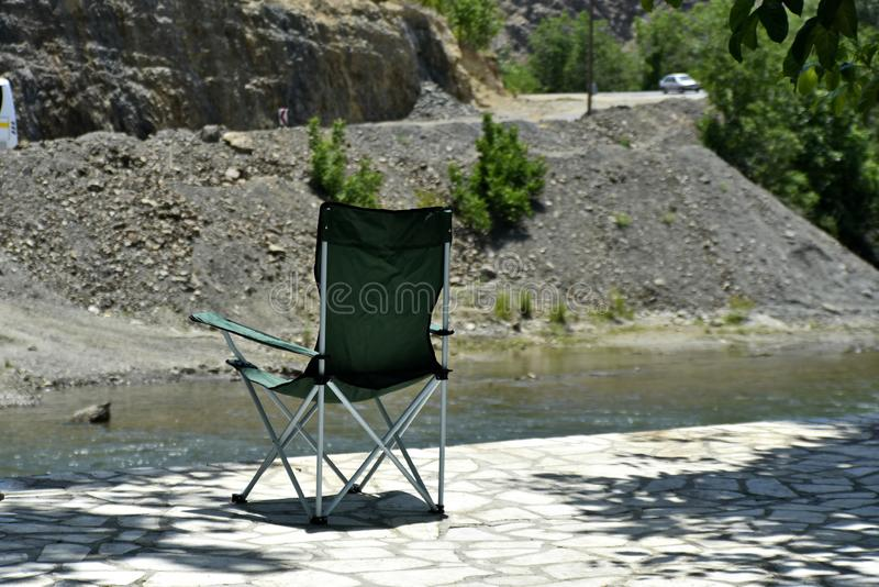 Safari Chair with the View of Zayandeh rood Zayanderud, Esfahan, Iran at the day.  stock photos