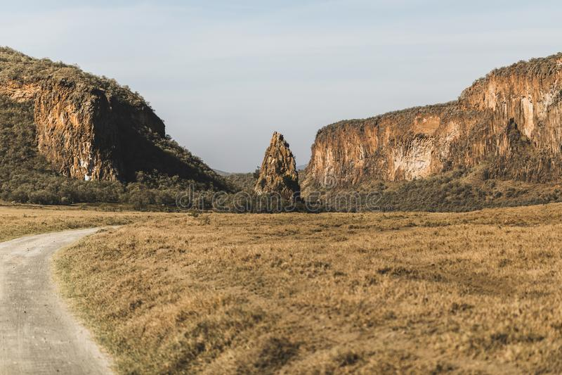 Safari in Hell`s Gate national park in Kenya. Basalt mountain and rock, main landmark. Explore wilderness of Africa royalty free stock image