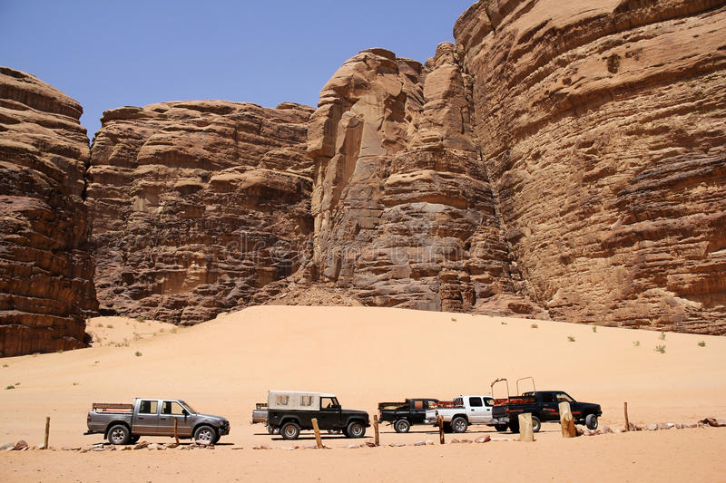 Safari jeeps in the valley of Laurence of Arabian stock images