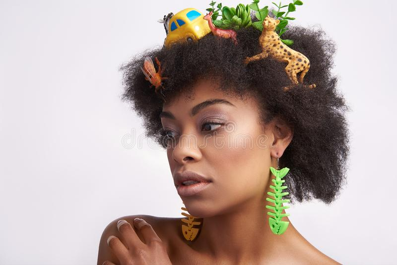 Sensual young ethnic lady with animals hairstyle stock photos