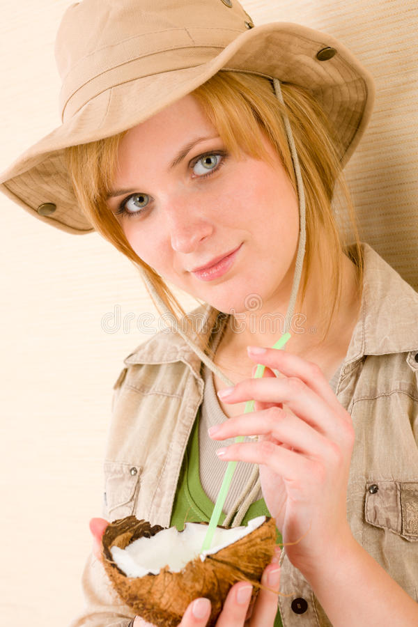 Safari young woman drink coconut straw royalty free stock images