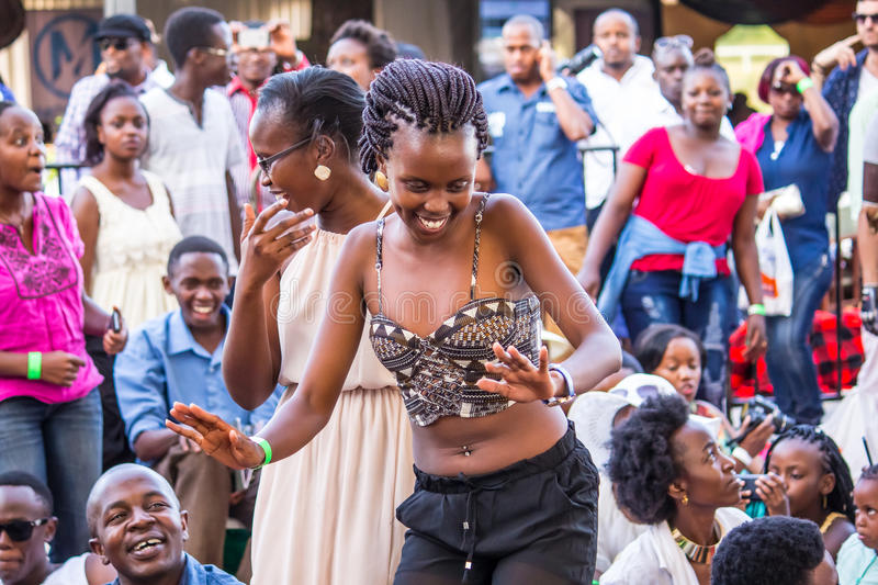 Safaricom Jazz Festival Fans. Fans at the Safaricom Jazz Festival enjoy the musical presentations at the Ngong Racecourse Grounds in Nairobi, Kenya on February stock images