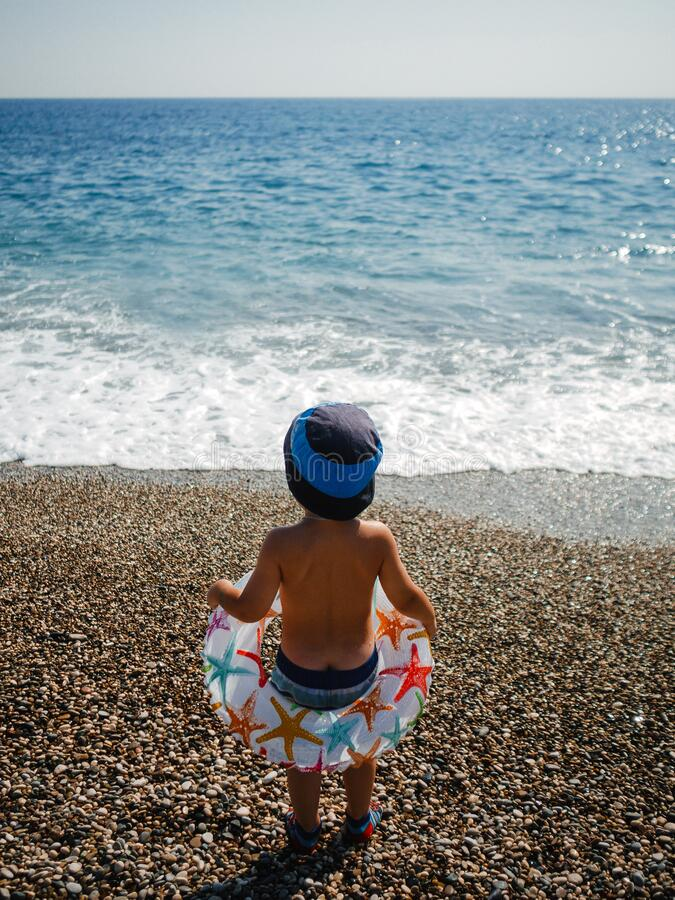 Safe bathing of children in the sea stock photography