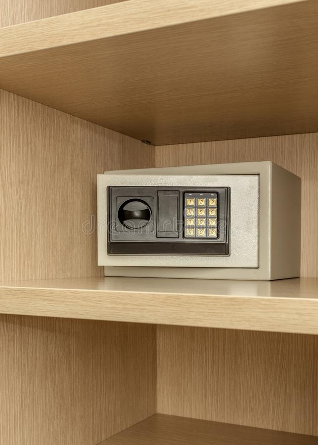 Safe box for storing valuables in a wooden cupboard. Inside stock images