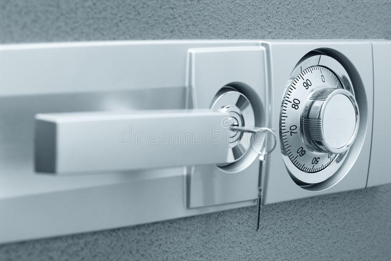 Safe with combination lock. Key and knob royalty free stock photography