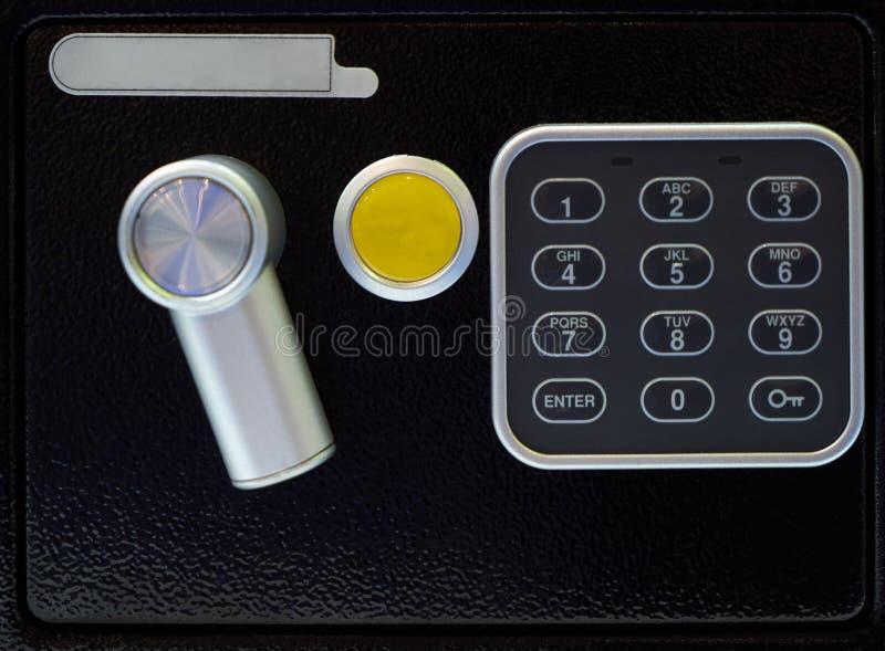 Safe door with code lock, close-up. Black metal safe deposit box stock photography