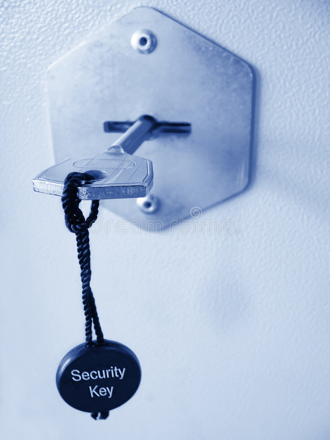 Safe key in a lock stock images