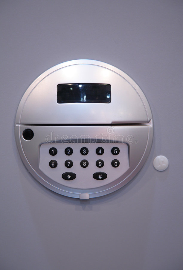 Safe keypad. On grey background royalty free stock photo
