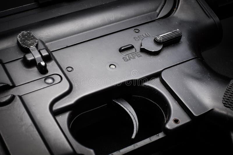 Safe mode assault rifle on black background royalty free stock photo