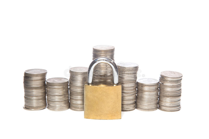 Safe money. Coins and padlocks isolated on a white background. Safe money. a Coins and padlocks isolated on a white background stock images
