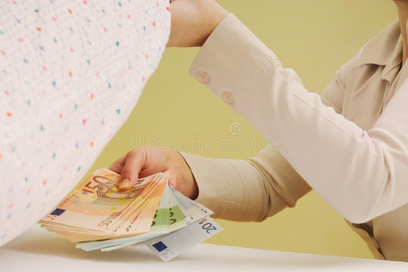 Safe Money - Hiding Money Under Pillow Royalty Free Stock Photography