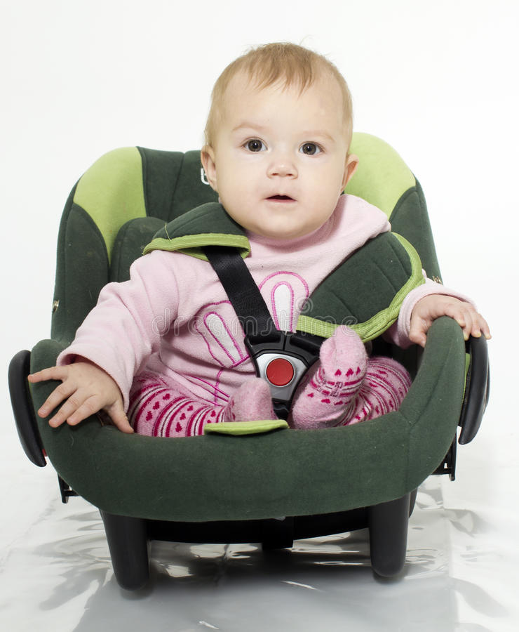 Safe place. The child in a children's cradle for the car stock photos