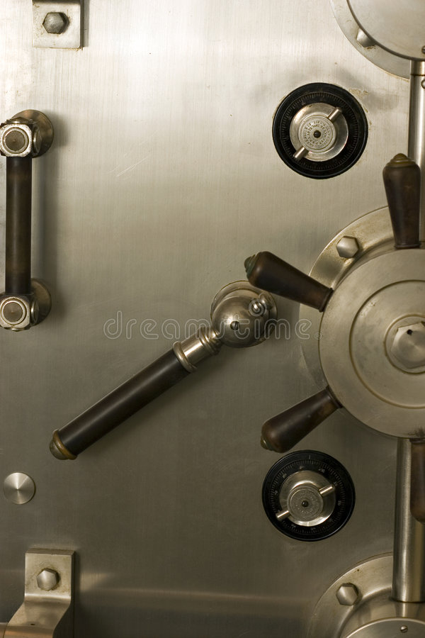 Safe and sound. An old safe door. Nobody is getting into this thing royalty free stock images