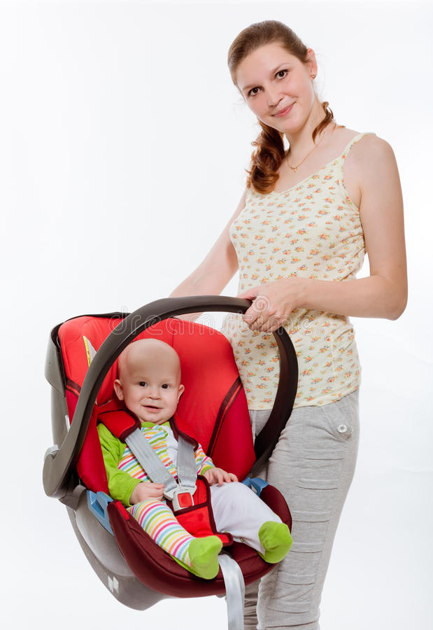 Safe transportation. The young women holds the babe in a cradle royalty free stock images