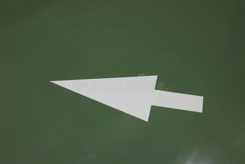Safety arrow and symbol on the floor stock photos