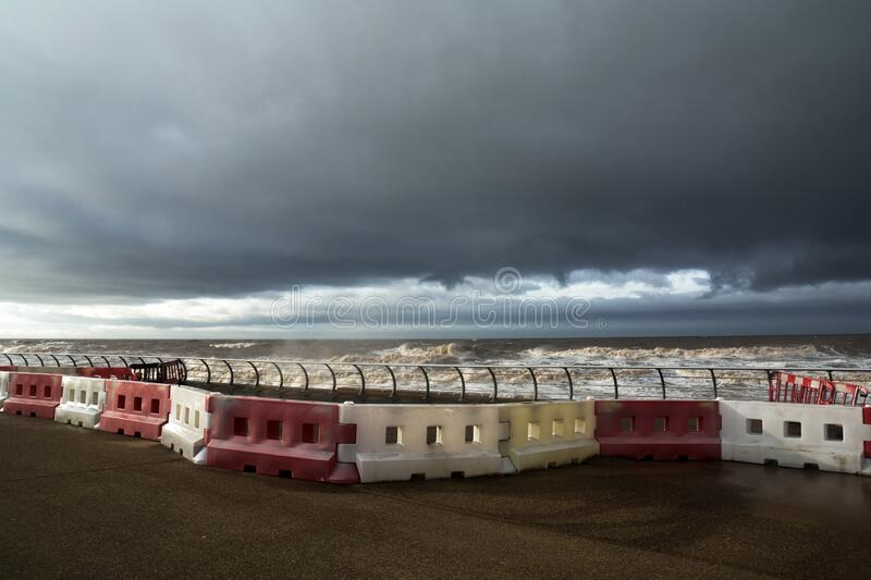 Safety barriers at the sea front as a storm approaches stock photos