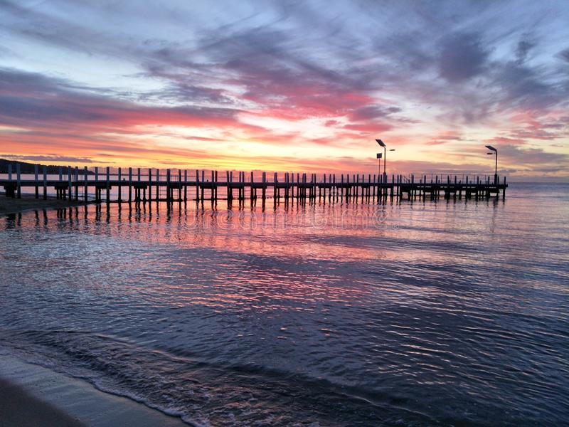 Sunset over jetty stock images