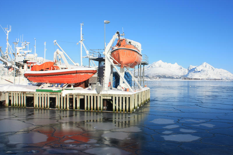 Safety boat on icy Lofoten's sea royalty free stock photo