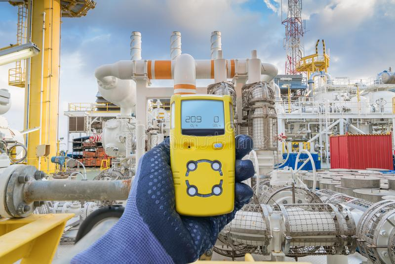 Safety concept of safety and security system on offshore oil and gas processing platform, hand hold gas detector for check. Hydrocarbon leak to protect fire and stock photo