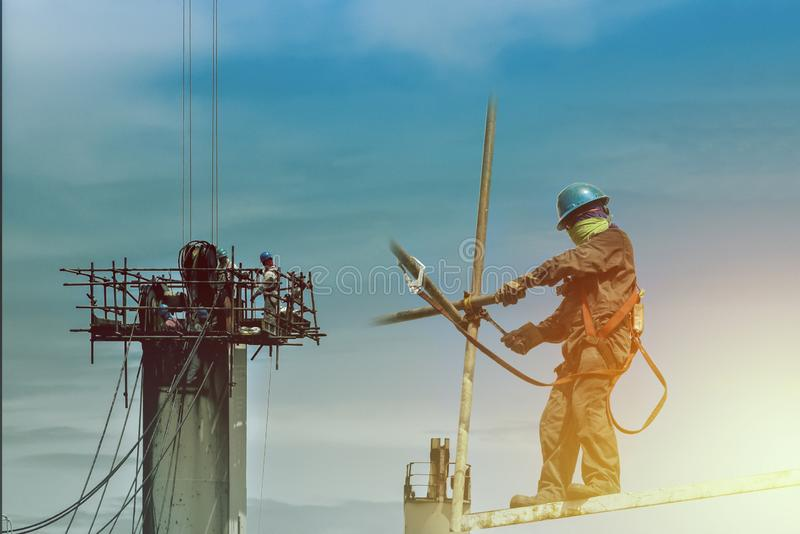 Safety, Construction wearing safety harness. stock images