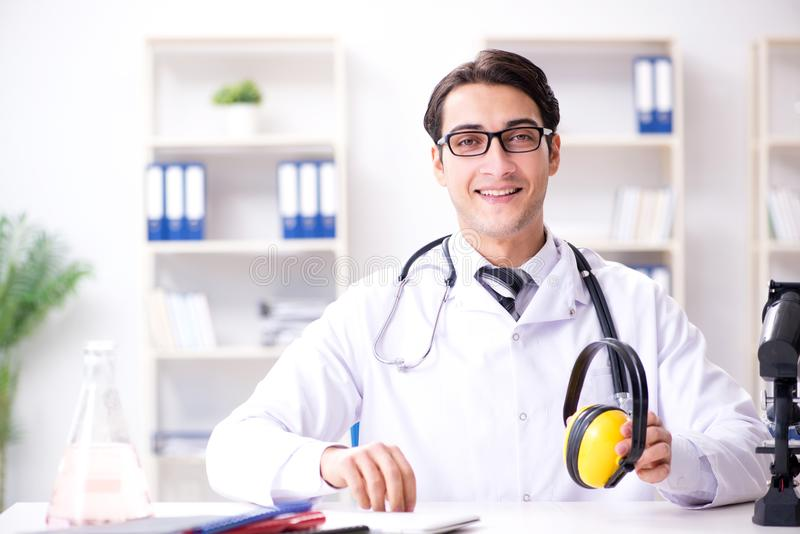 The safety doctor advising about noise cancelling headphones stock photos