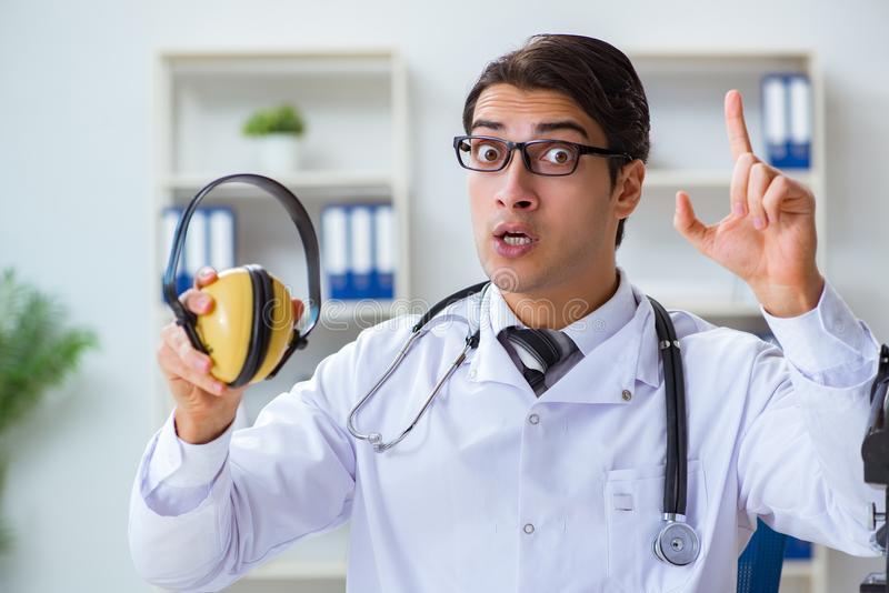 The safety doctor advising about noise cancelling headphones royalty free stock image